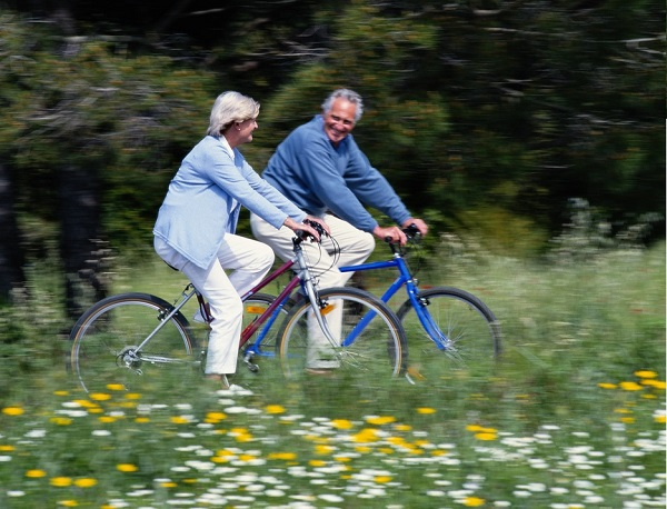 Two retirees biking in the country